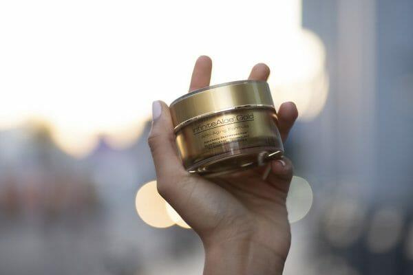 InfiniteAloe Gold Anti-Aging 1.7oz jar in hand