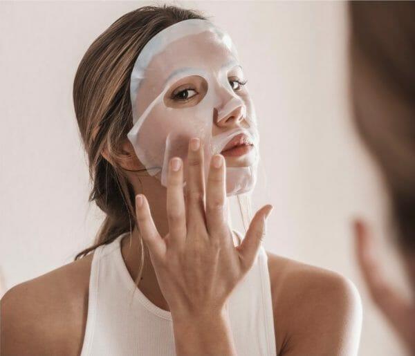 Woman using hydrating mask